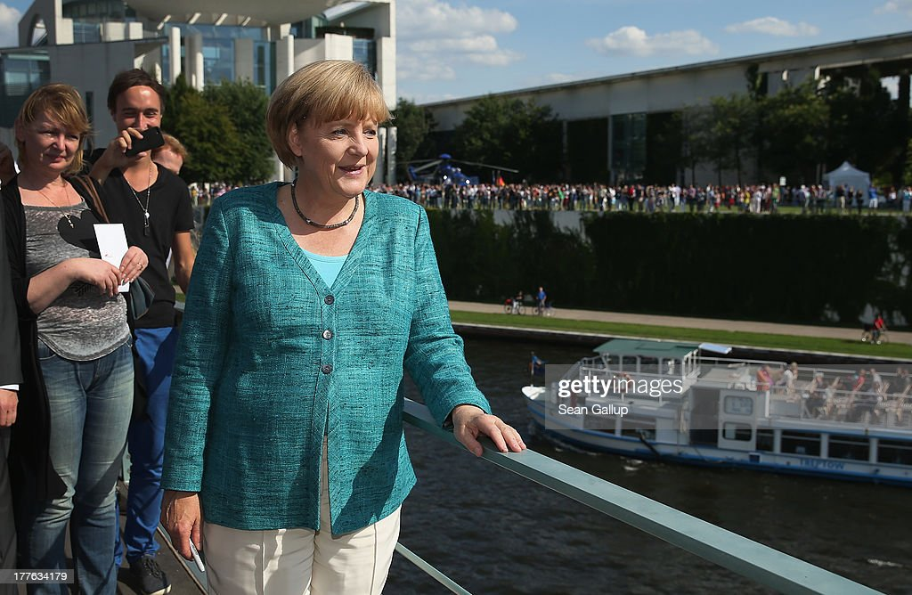 German Chancellor Angela Merkel looks out at visitors during the annual open-house day at the Chancellery on August 25, 2013 in Berlin, Germany. Germany is facing federal elections scheduled for September 22 and so far the CDU has a substantial lead in polls over the opposition.