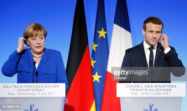 German Chancellor Angela Merkel makes a statement next to French President Emmanuel Macron during a joint press conference at the Elysee Presidential...