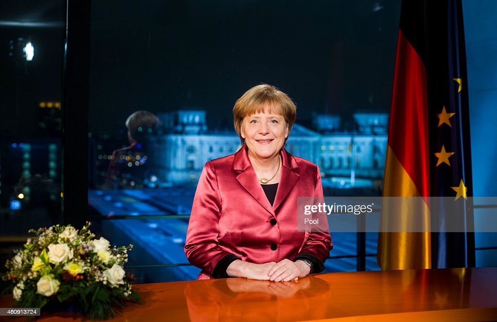 German Chancellor <a gi-track='captionPersonalityLinkClicked' href=/galleries/search?phrase=Angela+Merkel&family=editorial&specificpeople=202161 ng-click='$event.stopPropagation()'>Angela Merkel</a> makes her New Year's speech on December 30, 2014 in Berlin, Germany.