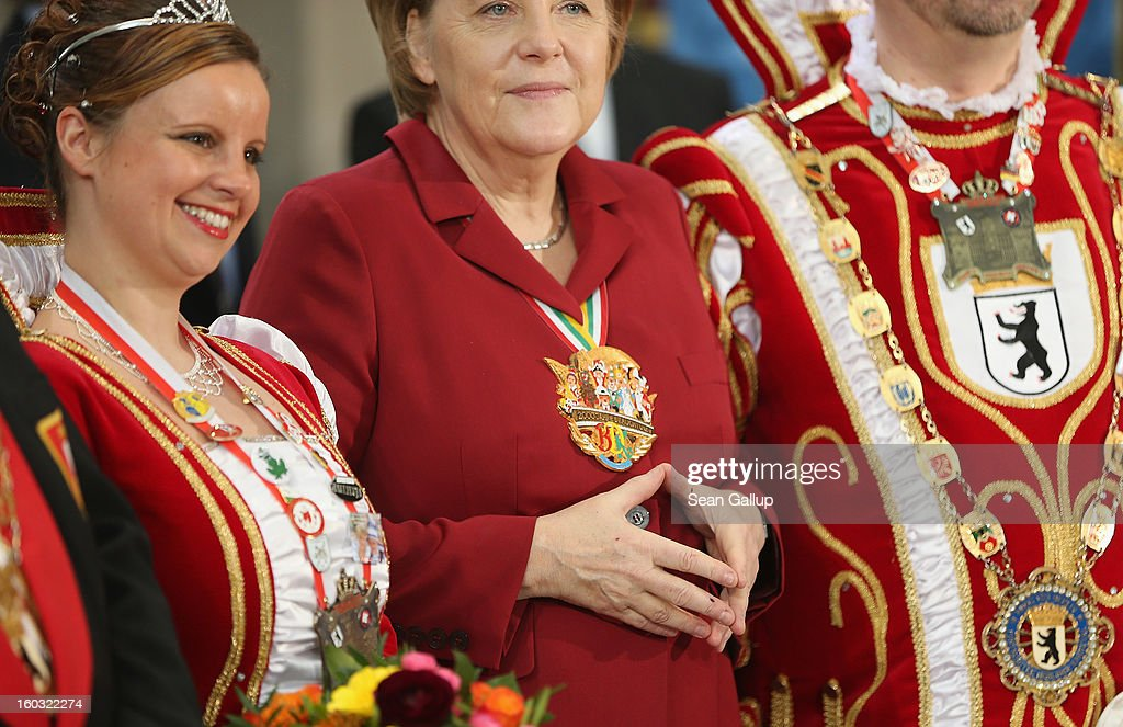 German Chancellor <a gi-track='captionPersonalityLinkClicked' href=/galleries/search?phrase=Angela+Merkel&family=editorial&specificpeople=202161 ng-click='$event.stopPropagation()'>Angela Merkel</a> makes her typical hands gesture while meeting with Carnival delegates from all over Germany in an annual ceremony at the Chancellery on January 29, 2013 in Berlin, Germany. Germany is in the midst of Carnival season, which ends with its highpoint between Rose Monday and Ash Wednesday in a tradition common in several countries in Europe and the Americas.