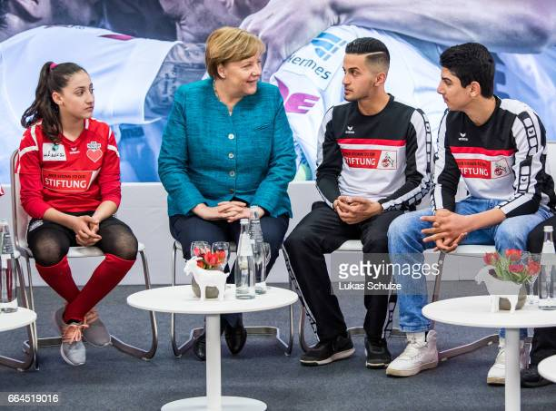 German Chancellor Angela Merkel meets members of the 1 FC Koeln Foundation and members of the initiative 'Wir zusammen' prior to the Bundesliga match...