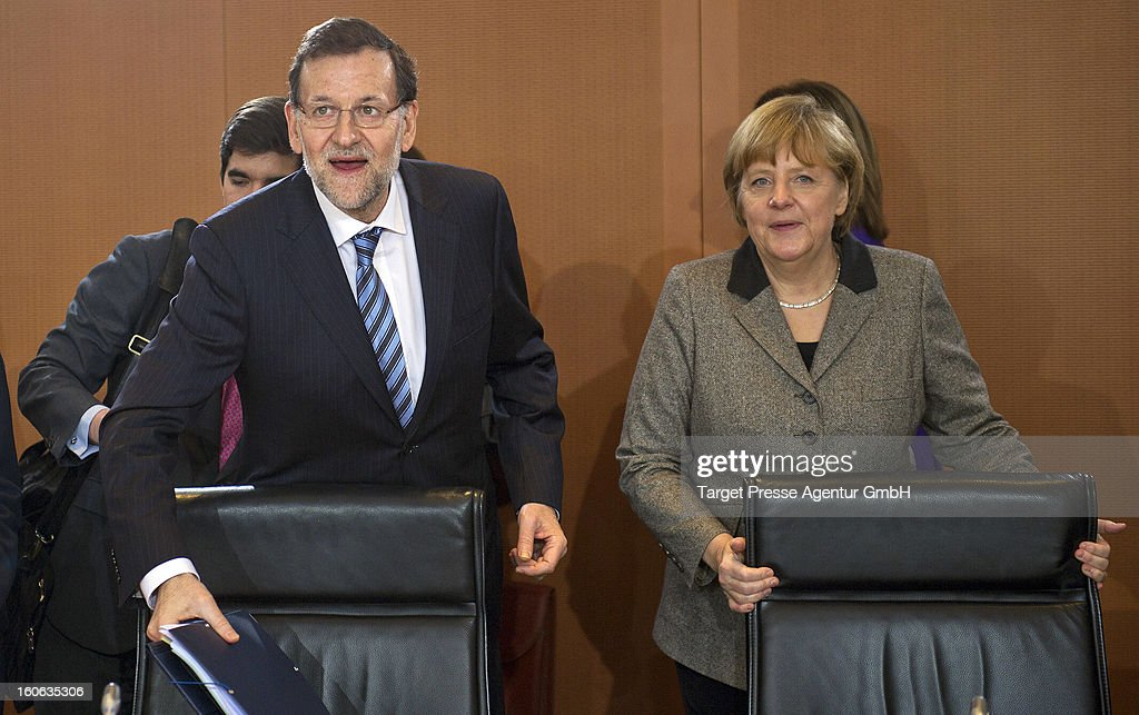 German Chancellor Angela Merkel (R) meets Spanish Prime Minister Mariano Rajoy at the Chancellery on February 4, 2013 in Berlin, Germany. The German and Spanish government are meeting for consultations, and the ongoing spanish economic downturn is likely to be high on the agenda.