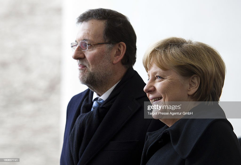 German Chancellor <a gi-track='captionPersonalityLinkClicked' href=/galleries/search?phrase=Angela+Merkel&family=editorial&specificpeople=202161 ng-click='$event.stopPropagation()'>Angela Merkel</a> meets Spanish Prime Minister Mariano Rajoy at the Chancellery on February 4, 2013 in Berlin, Germany. The German and Spanish government are meeting for consultations, and the ongoing spanish economic downturn is likely to be high on the agenda.