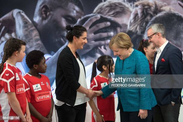 German Chancellor Angela Merkel meets with participants of the foundation for refugees 'Wir Zusammen' in cooperation with the German First division...