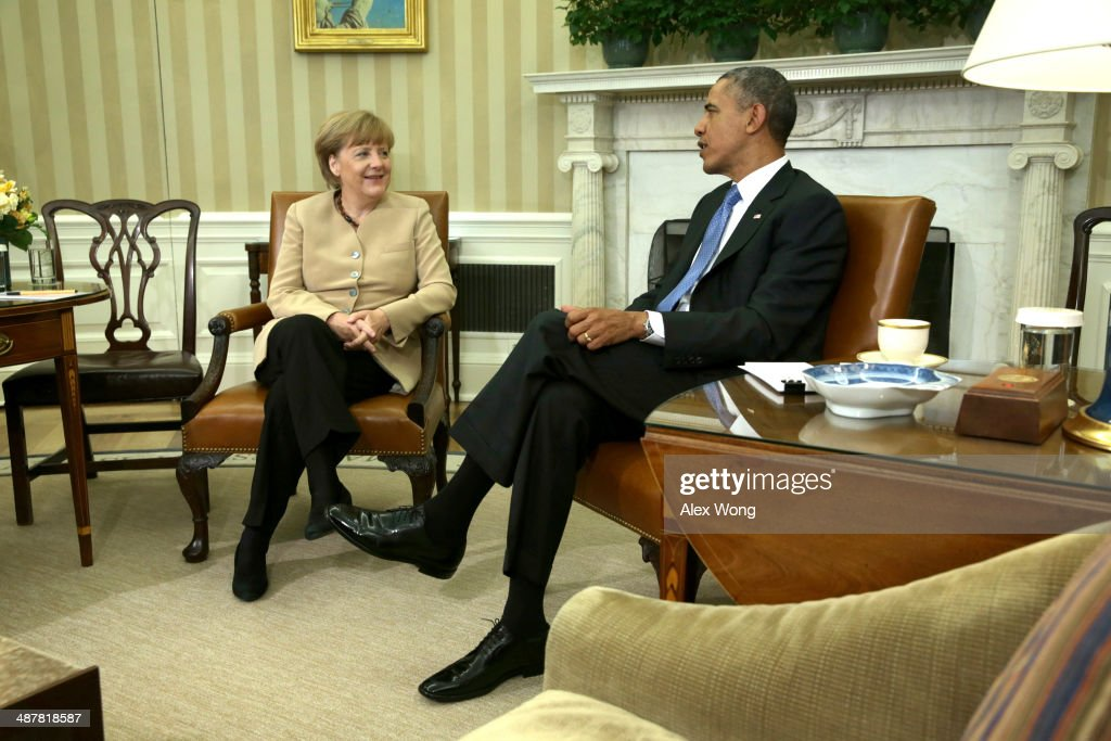 German Chancellor <a gi-track='captionPersonalityLinkClicked' href=/galleries/search?phrase=Angela+Merkel&family=editorial&specificpeople=202161 ng-click='$event.stopPropagation()'>Angela Merkel</a> meets with U.S. President <a gi-track='captionPersonalityLinkClicked' href=/galleries/search?phrase=Barack+Obama&family=editorial&specificpeople=203260 ng-click='$event.stopPropagation()'>Barack Obama</a> in the Oval Office of the White House May 2, 2014 in Washington, DC. Obama and Merkel emphasizied their continued support for the new government in Ukraine and their critisism of Russia after the failure of last month's Geneva Agreement. The Ukranian military said Friday that pro-Russiaon militants in the eastern part of the country had used sophisticated weapons to shoot down two of its helicopters.