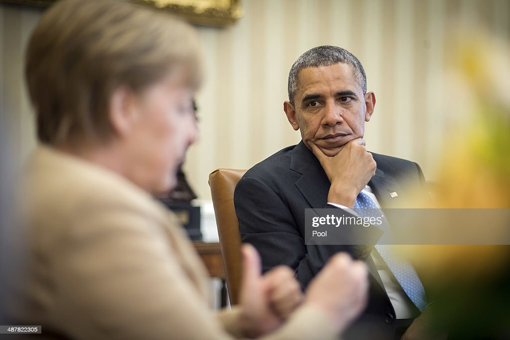 German Chancellor <a gi-track='captionPersonalityLinkClicked' href=/galleries/search?phrase=Angela+Merkel&family=editorial&specificpeople=202161 ng-click='$event.stopPropagation()'>Angela Merkel</a> meets with U.S. President <a gi-track='captionPersonalityLinkClicked' href=/galleries/search?phrase=Barack+Obama&family=editorial&specificpeople=203260 ng-click='$event.stopPropagation()'>Barack Obama</a> in the Oval Office of the White House May 2, 2014 in Washington, DC. Obama and Merkel emphasizied their continued support for the new government in Ukraine and their critisism of Russia after the failure of last month's Geneva Agreement.