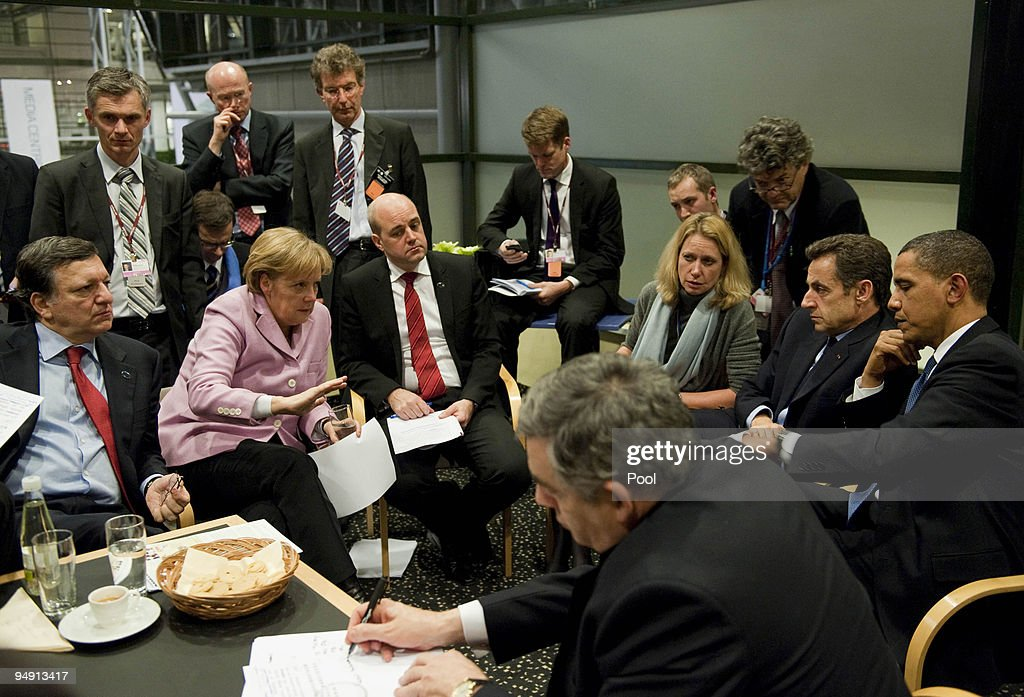 German Chancellor Angela Merkel (C) negotiates with president of the European Commission, Jose Manuel Barroso (L), Sweden's prime minister and standing president of the European Council, Fredrik Reinfeldt, (R), French President Nicolas Sarkozy, US President Barack Obama and British Prime Minister Gordon Brown the procedure of the European group of negotiations and the USA for the World Climate Conference during the final night of the UN Climate Change Summit on December 18, 2009 in Copenhagen, Denmark. World leaders will try to reach agreement on targets for reducing the earth's carbon emissions on this last day of the summit.