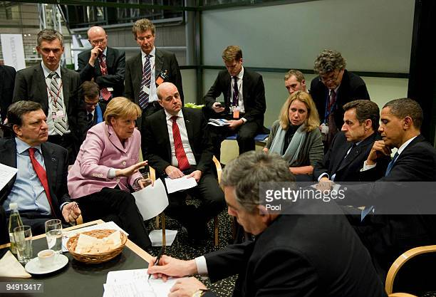 German Chancellor Angela Merkel negotiates with president of the European Commission Jose Manuel Barroso Sweden's prime minister and standing...