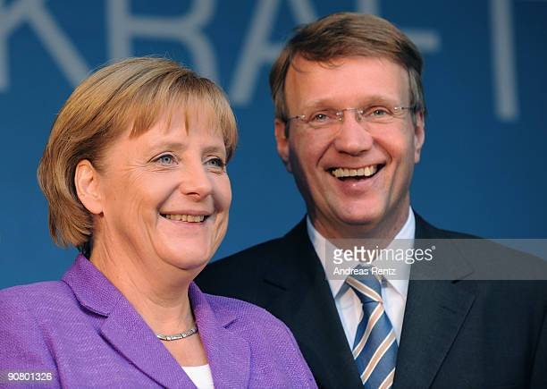 German Chancellor Angela Merkel of the Christian Democratic Union and Ronald Pofalla General Secretary of the CDU smile during their election...