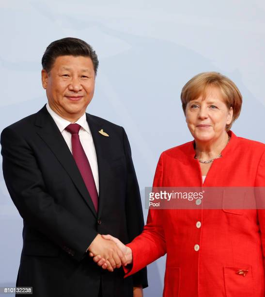German Chancellor Angela Merkel officially welcomes China's President Xi Jinping to the opening day of the G20 summit on July 7 2017 in Hamburg...