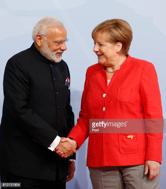 German Chancellor Angela Merkel officially welcomes Indian Prime Minister Narendra Modi to the opening day of the G20 summit on July 7 2017 in...