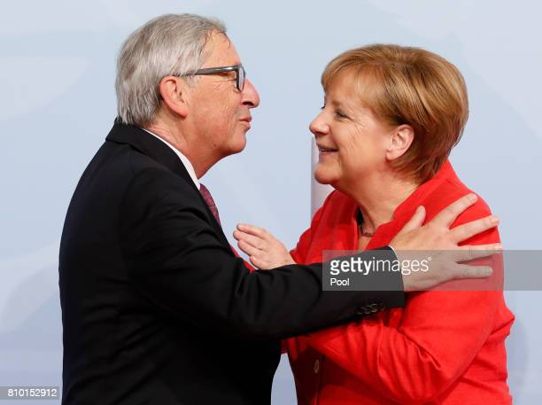 German Chancellor Angela Merkel officially welcomes President of the European Commission JeanClaude Juncker to the opening day of the G20 summit on...