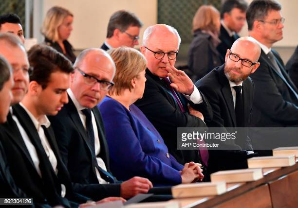 German Chancellor Angela Merkel parliamentary group leader of CDU/CSU faction Volker Kauder and CDU's Secretary General Peter Tauber attend the...