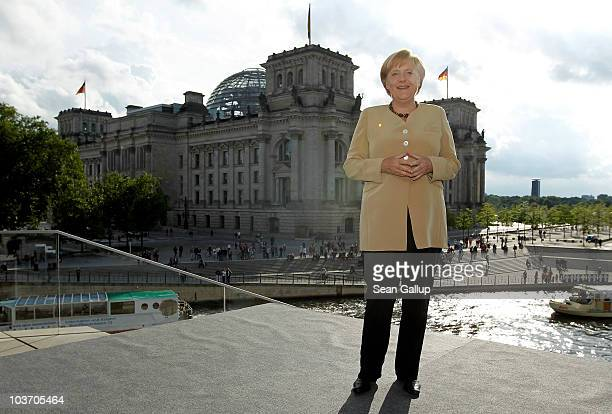 German Chancellor Angela Merkel pauses after her ARD television summer interview next to the Reichstag on August 29 2010 in Berlin Germany Merkel is...