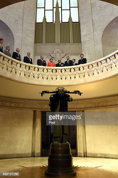 German Chancellor Angela Merkel pauses for a moments silence with fellow dignitaries as they look into the well of contemplation at the ANZAC...