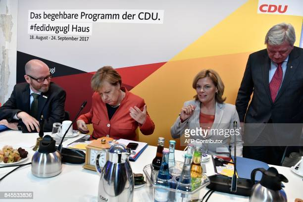 German Chancellor Angela Merkel Peter Tauber secretary general of the conservative Christian Democratic Union party Julia Kloeckner regional leader...