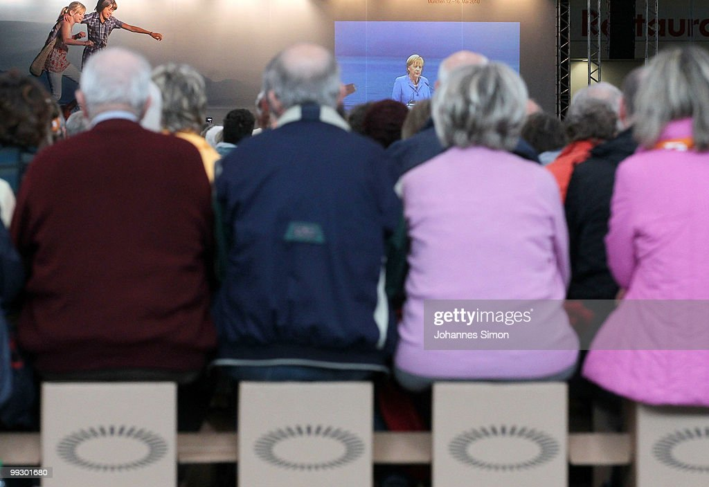 German Chancellor <a gi-track='captionPersonalityLinkClicked' href=/galleries/search?phrase=Angela+Merkel&family=editorial&specificpeople=202161 ng-click='$event.stopPropagation()'>Angela Merkel</a>, pictured on a giant screen delivers a speech during day 3 of the 2nd Ecumenical Church Day (2. Oekumenischer Kirchentag) at International Congress Center (ICC) on May 14, 2010 in Munich, Germany. Thousands will travel to the southern German city to take part in the Church Day events been held from May 12 to May 16, 2010.