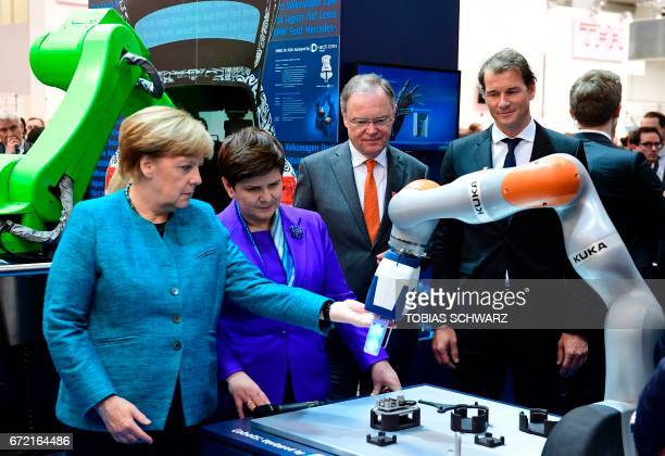 German Chancellor Angela Merkel Polish Prime Minister Beata Szydlo Lower Saxony's State Premier Stephan Weil and Germany's national football team's...