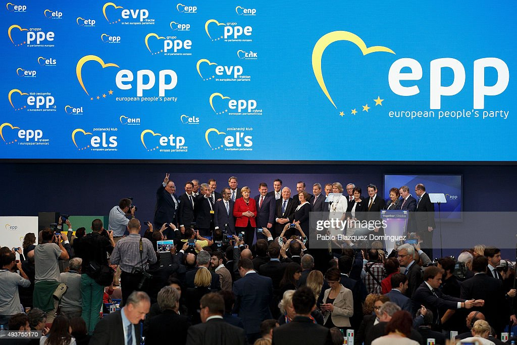 German Chancellor Angela Merkel poses for a group picture with other members of the EPP during the plenary session of the European People's Party...
