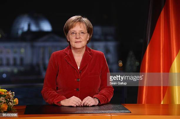 German Chancellor Angela Merkel poses moments after delivering her New Year's television address to the nation at the Chancellery on December 30 2009...