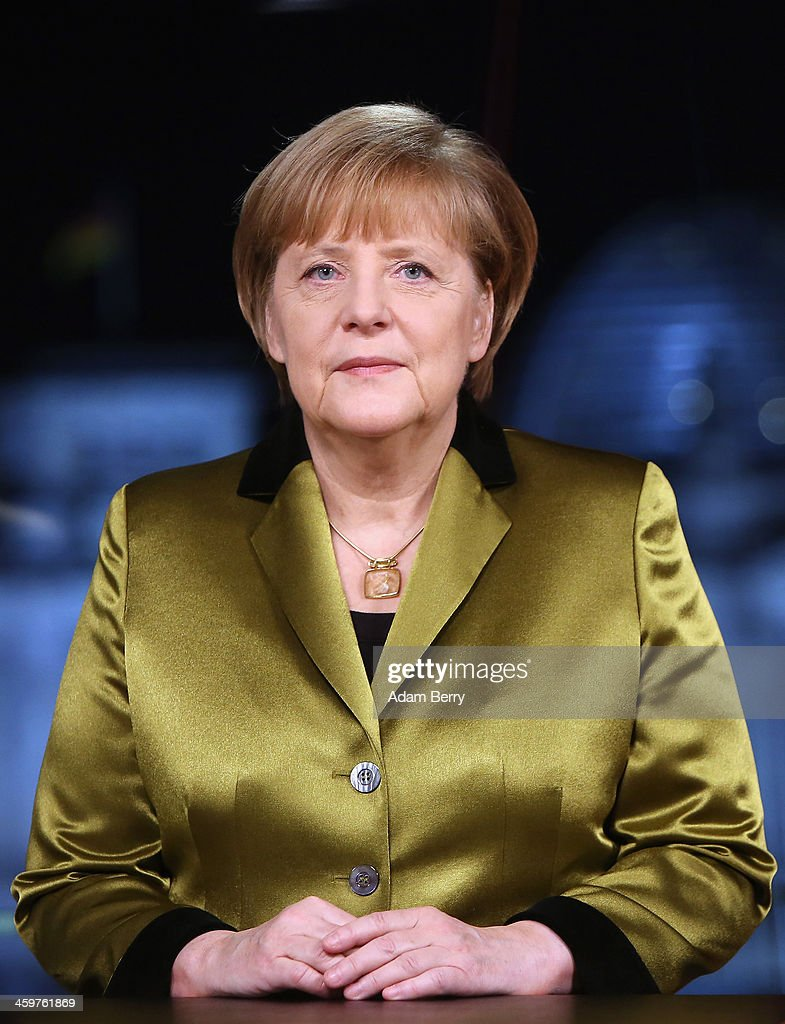 German Chancellor <a gi-track='captionPersonalityLinkClicked' href=/galleries/search?phrase=Angela+Merkel&family=editorial&specificpeople=202161 ng-click='$event.stopPropagation()'>Angela Merkel</a> poses moments after giving her New Year's television address to the nation at the federal chancellery (Bundeskanzleramt) on December 30, 2013 in Berlin, Germany. Merkel spoke of the challenges and priorities set for the German government for 2014.