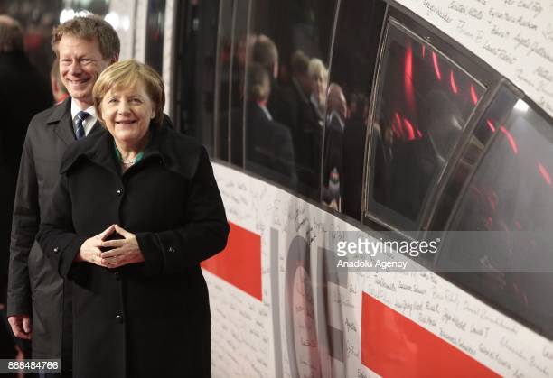 German Chancellor Angela Merkel poses with Deutsche Bahn CEO Richard Lutz at the Berlin central train station or Hauptbahnhof with the ICE...