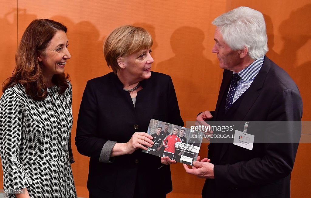 German Chancellor Angela Merkel takes part in an annual integration summit at the chancellery in Berlin