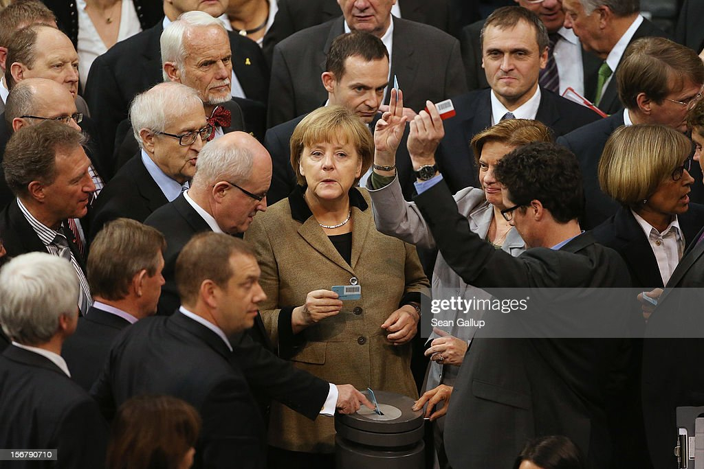 German Chancellor <a gi-track='captionPersonalityLinkClicked' href=/galleries/search?phrase=Angela+Merkel&family=editorial&specificpeople=202161 ng-click='$event.stopPropagation()'>Angela Merkel</a> prepares to cast her ballot on a measure at the Bundestag over the 2013 federal budget on November 21, 2012 in Berlin, Germany. Bundestag members are debating the budget over four days this week and will vote on the final budget on Friday.