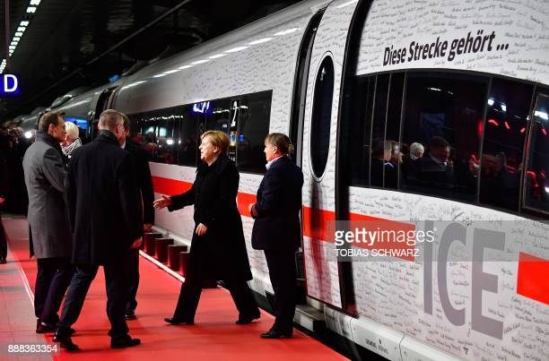 German Chancellor Angela Merkel prepares to shake hands with Berlin's mayor Michael Mueller in front of a special ICE high speed train of German...