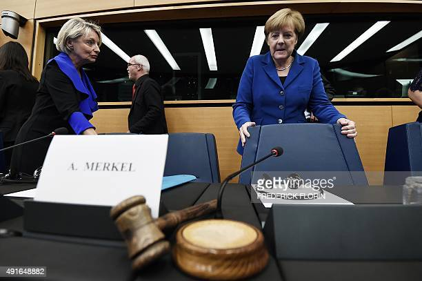 German Chancellor Angela Merkel prepares to take her seat upon arrival at the European Parliament in Strasbourg eastern France on October 7 2015...