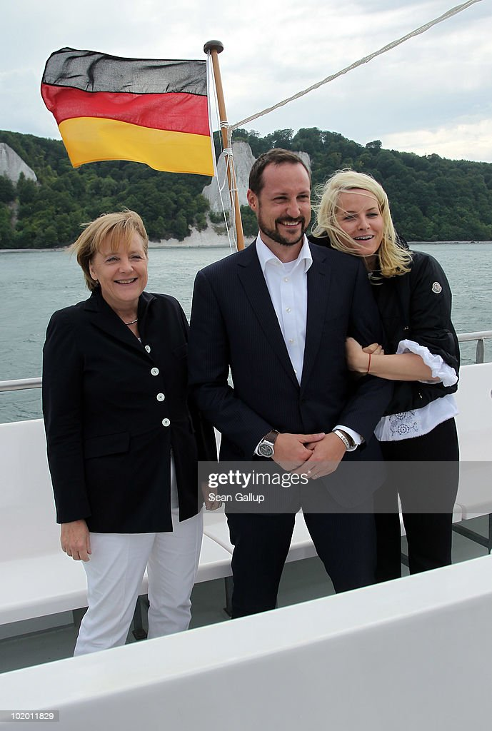 German Chancellor <a gi-track='captionPersonalityLinkClicked' href=/galleries/search?phrase=Angela+Merkel&family=editorial&specificpeople=202161 ng-click='$event.stopPropagation()'>Angela Merkel</a> (L), Princess Mette-Marit of Norway and Prince Haakon of Norway ride a boat along chalk cliffs in the Baltic Sea on June 12, 2010 near Sassnitz, Germany. The Norwegian prince and princess are on a one-day visit to northern Germany.