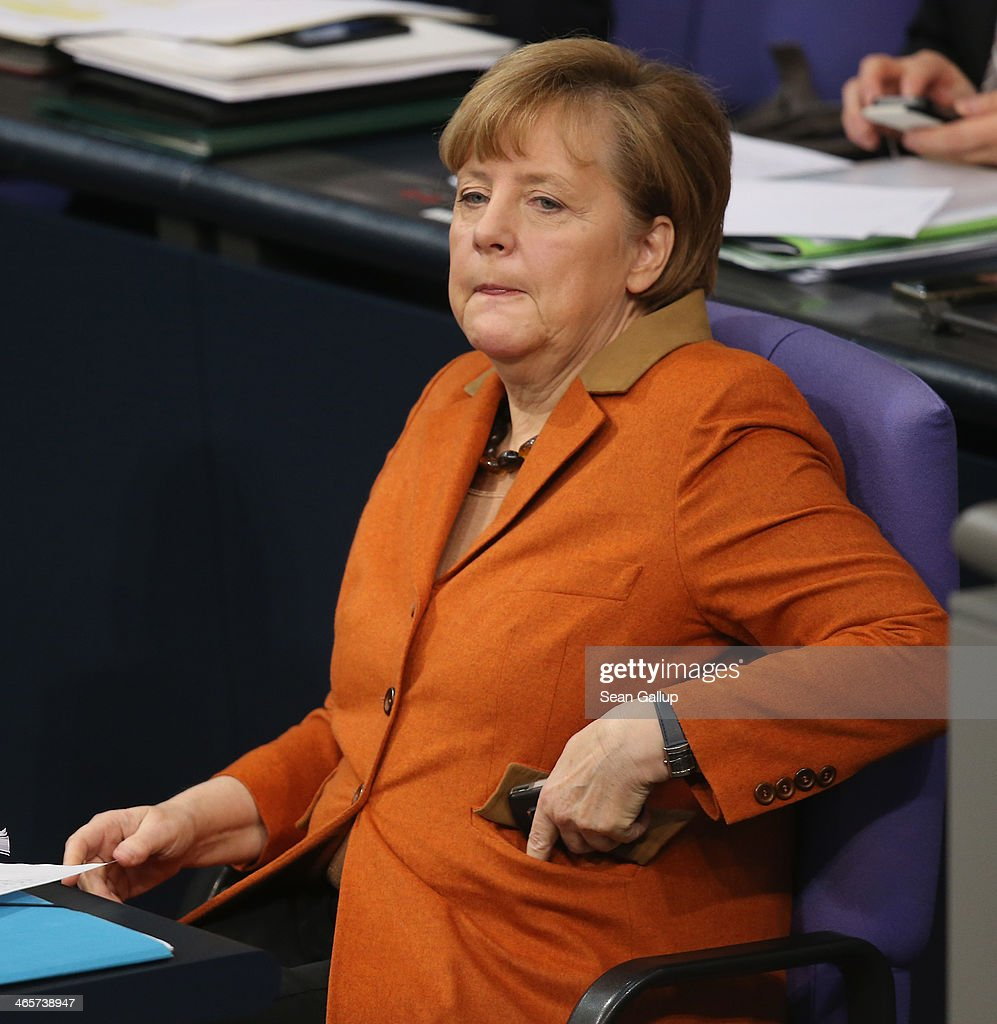 German Chancellor Angela Merkel puts a smartphone in her pocket after using it during debates at the Bundestag after she gave a government declaration to outline the policy priorities of the new German coalition government of Christian Democrats and Social Democrats on January 29, 2104 in Berlin, Germany. Revelations by Edward Snowden in 2013 that the U.S. National Security Agency (NSA) had eavesdropped on Merkel's phone caused a scandal and rift between German and U.S. relations that is still being echoed in current political debates.