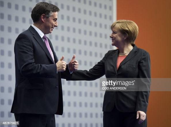 German Chancellor Angela Merkel reacts as David McAllister CDU top candidate for the upcoming European electionsgestures a thumbs up after addressing...