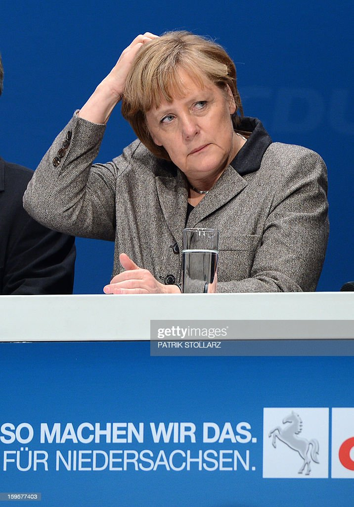 German Chancellor Angela Merkel reacts during an election campaign event of the regional Christian Democratic Union (CDU) party for the 2013 state elections in Osnabrueck, northern Germany, on January 16, 2013. Prime Minister of German Federal State, Lower-Saxony, David McAllister started his election campaign to keep his post as Lower Saxony's State Premier after regional elections on January 20, 2013. AFP PHOTO / PATRIK STOLLARZ