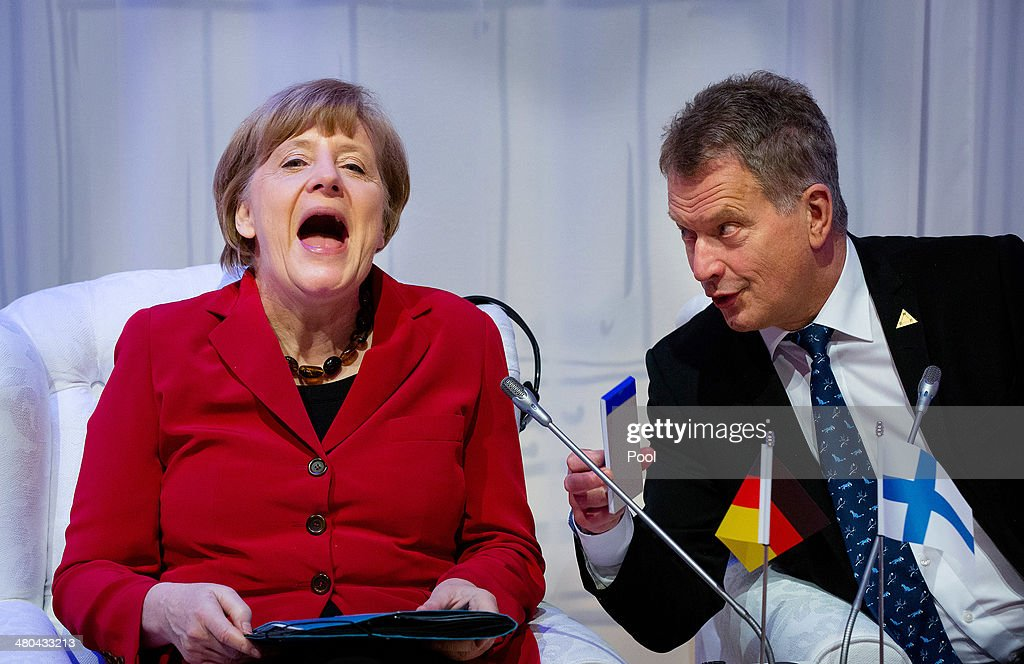 German Chancellor <a gi-track='captionPersonalityLinkClicked' href=/galleries/search?phrase=Angela+Merkel&family=editorial&specificpeople=202161 ng-click='$event.stopPropagation()'>Angela Merkel</a> (L) reacts next to President of Finland Sauli Niinisto during the 2014 Nuclear Security Summit on March 25, 2014 in The Hague, Netherlands. Leaders from around the world have come to discuss matters related to international nuclear security, though the summit has been overshadowed by recent events in Ukraine.