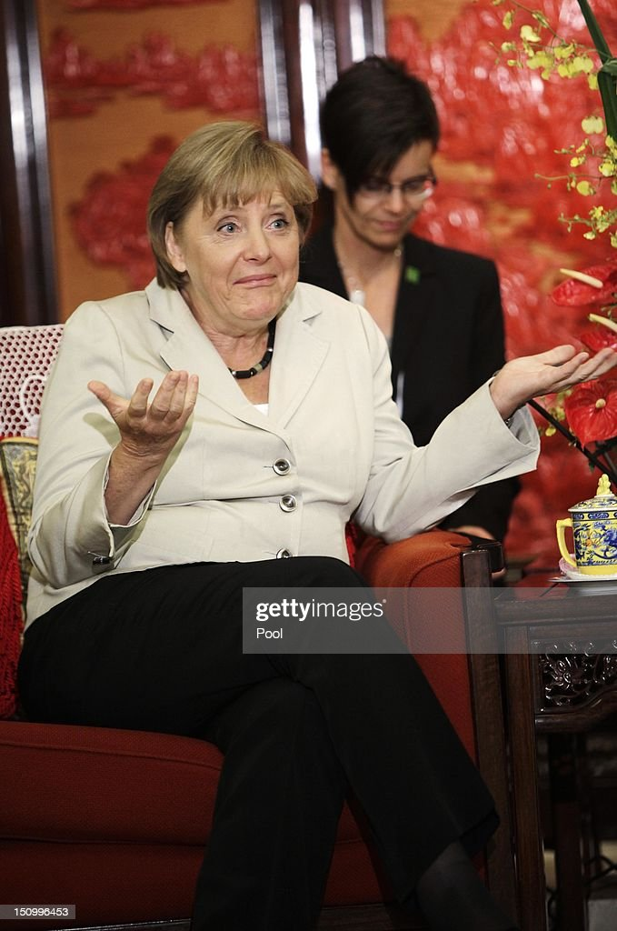 German Chancellor Angela Merkel reacts while talking to Chinese Vice-Premier Li Keqiang (not pictured) during their meeting at the Zhongnanhai diplomatic compound on August 30, 2012 in Beijing, China. Merkel is on a two-day official visit to China.