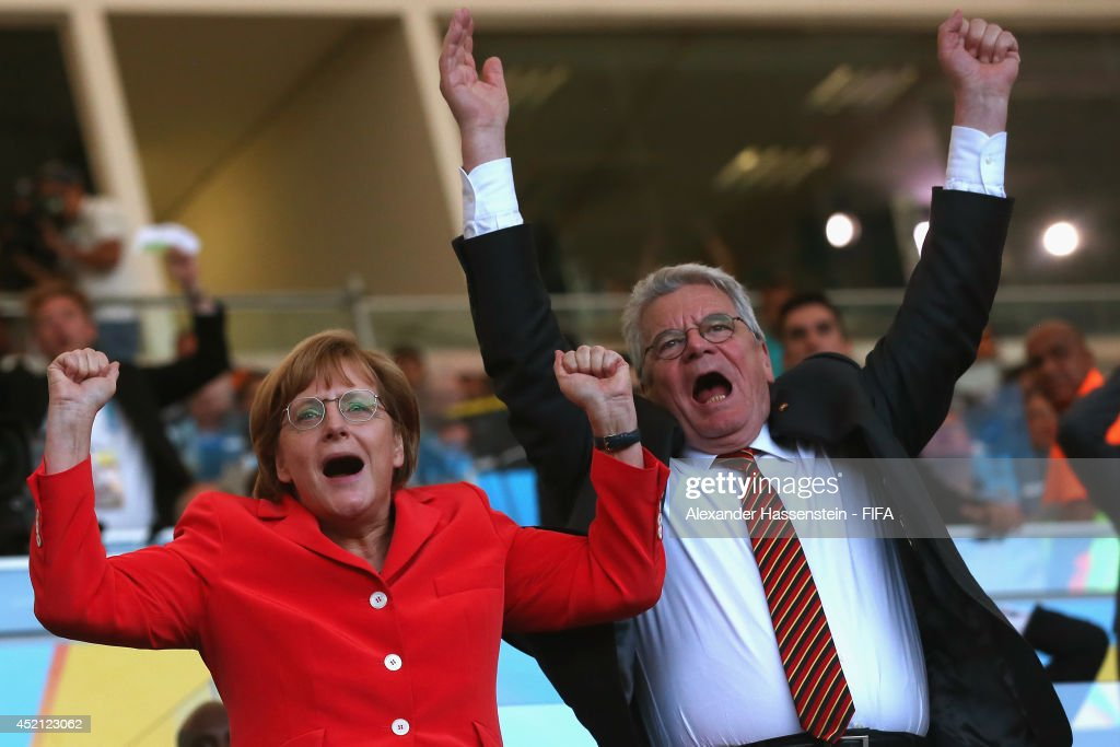 German Chancellor Angela Merkel reacts with German President Joachim Gauck during the 2014 FIFA World Cup Brazil Final match between Germany and Argentina at Maracana on July 13, 2014 in Rio de Janeiro, Brazil.