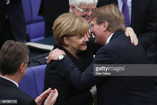 German Chancellor Angela Merkel receives congratulations from colleague Ronald Pofalla following her reelection for her third term as chancellor at...