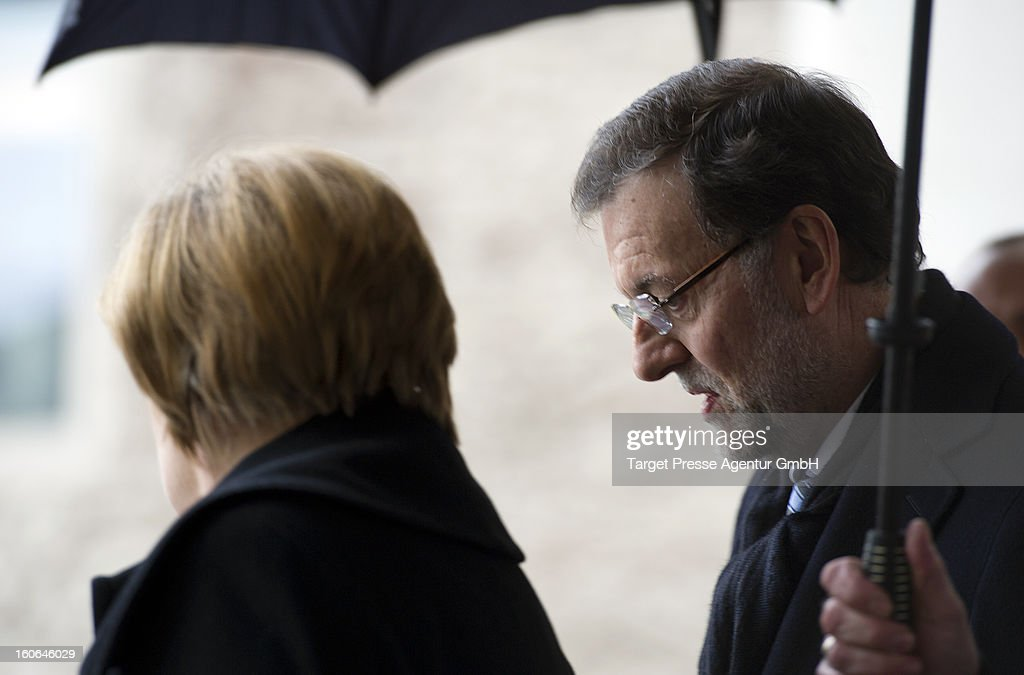 German Chancellor <a gi-track='captionPersonalityLinkClicked' href=/galleries/search?phrase=Angela+Merkel&family=editorial&specificpeople=202161 ng-click='$event.stopPropagation()'>Angela Merkel</a> receives Spanish Prime Minister Mariano Rajoy at the Chancellery on February 4, 2013 in Berlin, Germany. The German and Spanish government are meeting for consultations, and the ongoing spanish economic downturn is likely to be high on the agenda.
