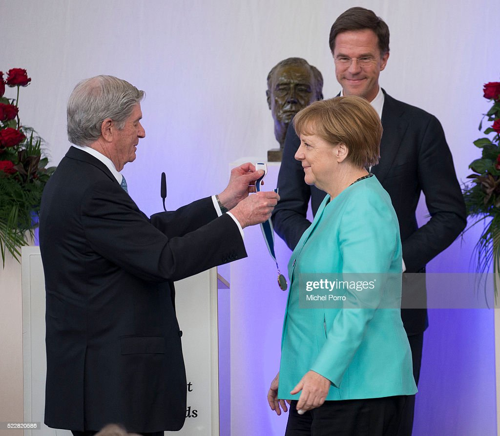 German Chancellor Angela Merkel receives the Four Freedoms Award from Elliott Roosevelt while Dutch Prime Minister Mark Rutte looks on during the...