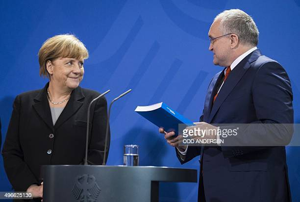 German Chancellor Angela Merkel receives the German Council of Economic Experts Annual Economic Report from GCEE chairman Christoph M Schmidt at the...