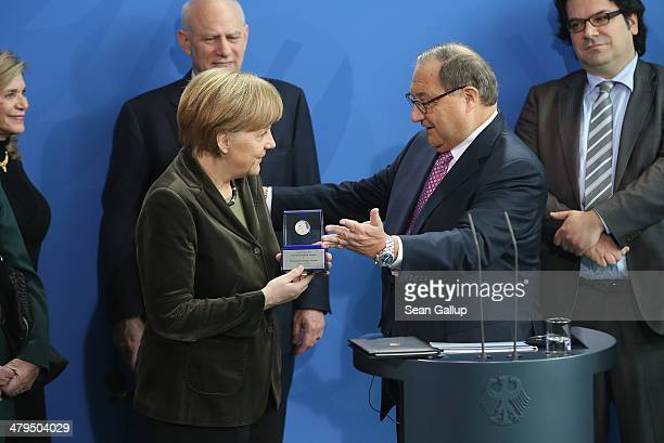 German Chancellor Angela Merkel receives the Joseph Prize for Human Rights from Abraham Foxman National Director of the AntiDefamation League during...