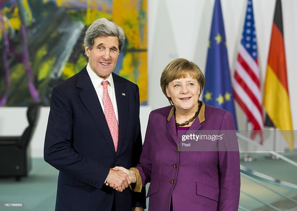 German Chancellor <a gi-track='captionPersonalityLinkClicked' href=/galleries/search?phrase=Angela+Merkel&family=editorial&specificpeople=202161 ng-click='$event.stopPropagation()'>Angela Merkel</a> receives U.S. Secretary of State <a gi-track='captionPersonalityLinkClicked' href=/galleries/search?phrase=John+Kerry&family=editorial&specificpeople=154885 ng-click='$event.stopPropagation()'>John Kerry</a> as they give a statement to the press on February 26, 2013 in Berlin, Germany. Kerry is in Germany on his first visit abroad as secretary of state, on an 11-day trip that will also take in Paris, Rome, Ankara, Cairo, Riyadh, Abu Dhabi and Doha, before he returns to the United States on March 6. Kerry spent yesterday in London, holding talks with Prime Minister David Cameron and Foreign Secretary William Hague.