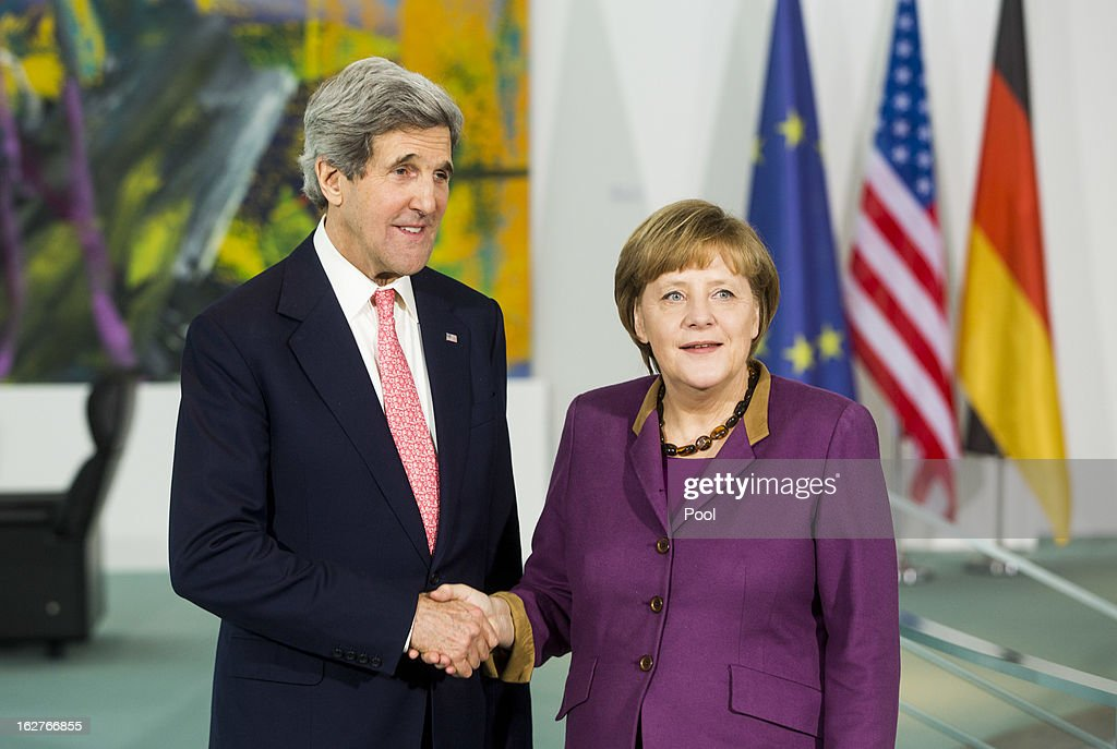 German Chancellor Angela Merkel receives U.S. Secretary of State John Kerry as they give a statement to the press on February 26, 2013 in Berlin, Germany. Kerry is in Germany on his first visit abroad as secretary of state, on an 11-day trip that will also take in Paris, Rome, Ankara, Cairo, Riyadh, Abu Dhabi and Doha, before he returns to the United States on March 6. Kerry spent yesterday in London, holding talks with Prime Minister David Cameron and Foreign Secretary William Hague.