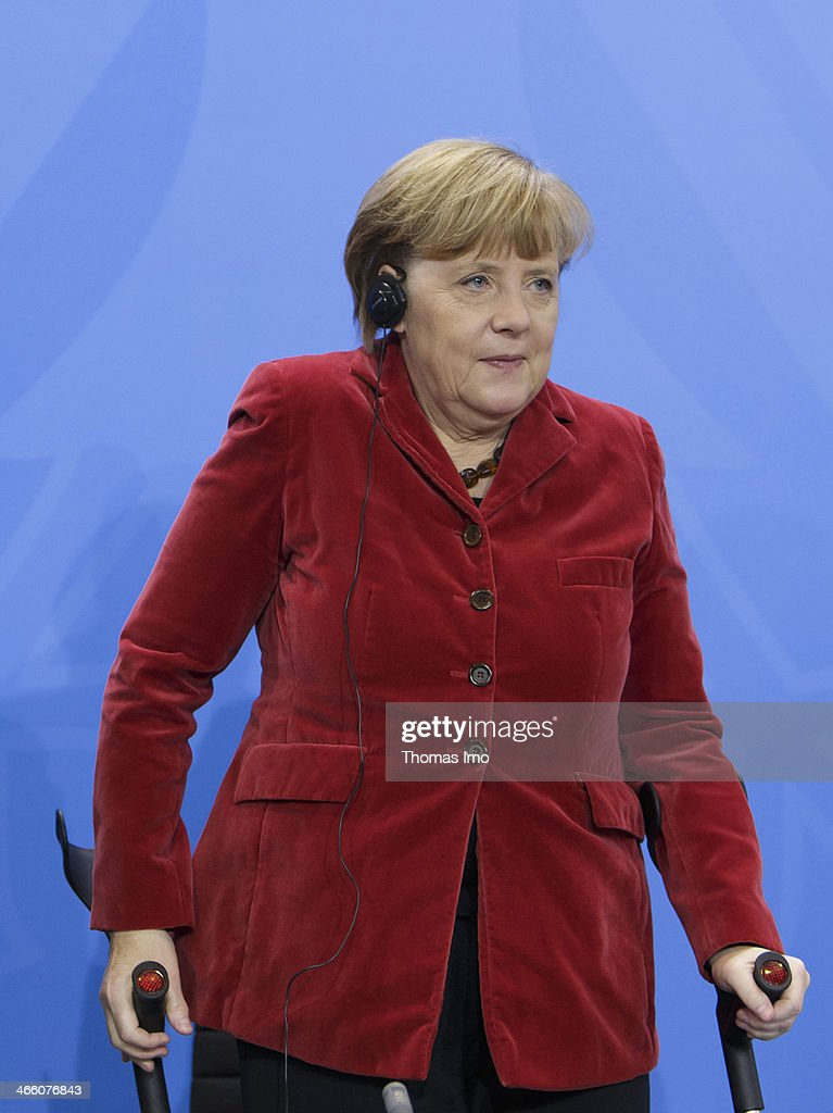 German Chancellor <a gi-track='captionPersonalityLinkClicked' href=/galleries/search?phrase=Angela+Merkel&family=editorial&specificpeople=202161 ng-click='$event.stopPropagation()'>Angela Merkel</a> seen on crutches during her meeting with Polish Prime Minister Donald Tusk (not pictured) on January 31, 2014 in Berlin, Germany.