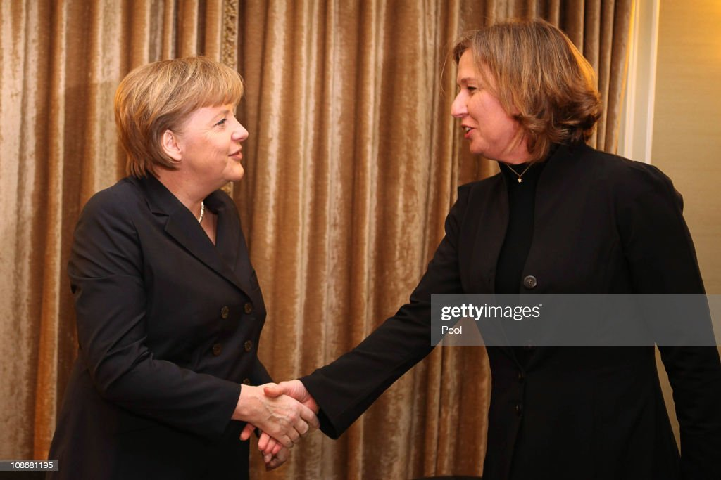 German Chancellor Angela Merkel (L) shakes hand with Israeli opposition leader <a gi-track='captionPersonalityLinkClicked' href=/galleries/search?phrase=Tzipi+Livni&family=editorial&specificpeople=537394 ng-click='$event.stopPropagation()'>Tzipi Livni</a> at the start of their meeting on February 01, 2011 in Jerusalem. Merkel has travelled to Israel with members of her cabinet in order to conduct joint government cabinet meetings with their Israeli counterparts.