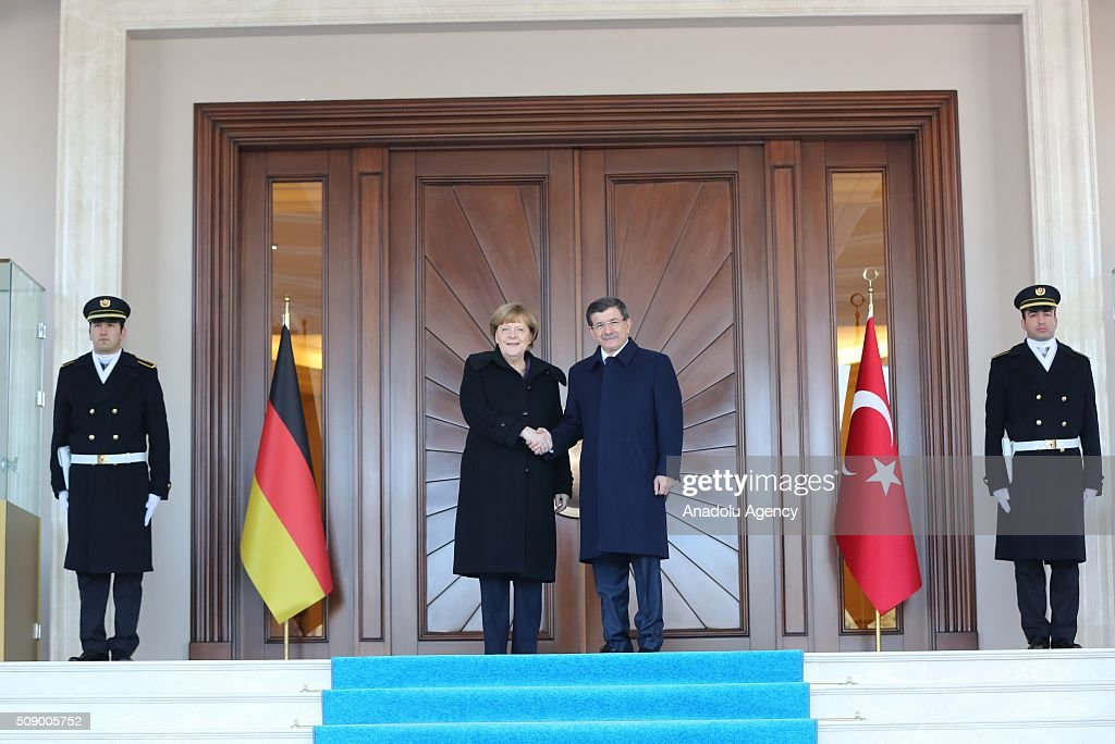 German Chancellor Angela Merkel shakes hand with Prime Minister of Turkey Ahmet Davutoglu (C-R) during the official welcoming ceremony in Ankara, Turkey on February 8, 2016.