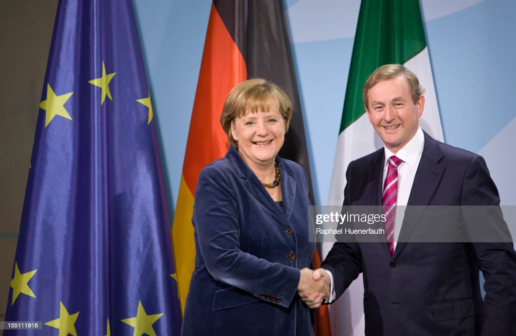 German Chancellor <a gi-track='captionPersonalityLinkClicked' href=/galleries/search?phrase=Angela+Merkel&family=editorial&specificpeople=202161 ng-click='$event.stopPropagation()'>Angela Merkel</a> (L) shakes hands with Irish Taoiseach (Prime Minister) <a gi-track='captionPersonalityLinkClicked' href=/galleries/search?phrase=Enda+Kenny&family=editorial&specificpeople=5129605 ng-click='$event.stopPropagation()'>Enda Kenny</a> (R) after a joint press conference at the Federal Chancellery on November 1, 2012 in Berlin, Germany. Merkel met with Kenny for talks about Irish banking sector and the forthcoming Irish EU presidency.