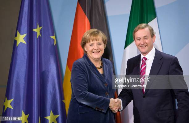 German Chancellor Angela Merkel shakes hands with Irish Taoiseach Enda Kenny after a joint press conference at the Federal Chancellery on November 1...