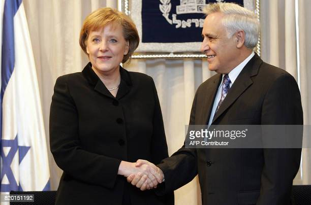 German Chancellor Angela Merkel shakes hands with Israeli president Moshe Katsav 30 January 2006 at his residence in JerusalemIsrael was looking to...